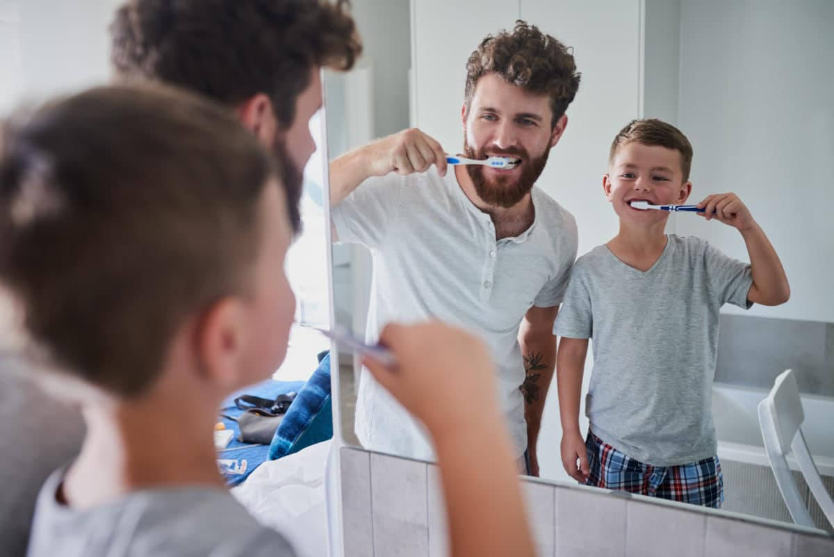 Father and son brushing their teeth | Teeth cleaning